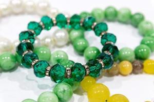 Pearl bracelets on white background photo
