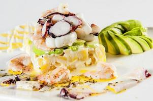 Causa stuffed with seafood traditional dish of Peruvian cuisine photo