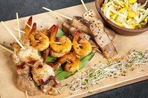 Mixed skewers chicken fish and cow meat photo