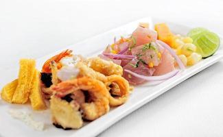 Peruvian food chicharrones de pescado with ceviche cebiche photo