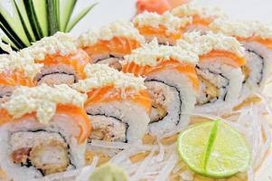 Roll with Cream Cheese and Cucumber inside Salmon topped photo