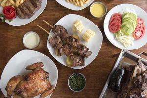 anticuchos Peruvian cuisine grilled skewered beef heart meat with boiled potato and white corn photo