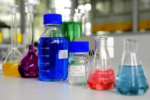 Laboratory glassware containing colorful chemical liquid photo