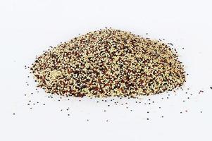 Black red and white quinoa grains isolated on white background photo