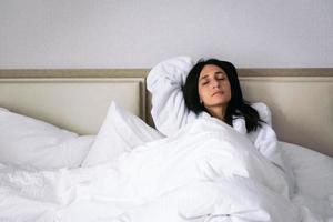 Woman enjoying holiday in hotel room photo