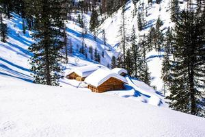 Alpine hut in the snow photo