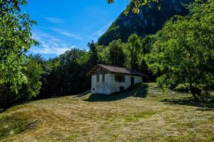 Shed and lawn at Lake Ledro in Trento, Italy photo