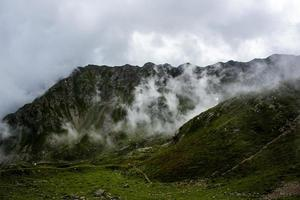 Granite mountains and clouds photo