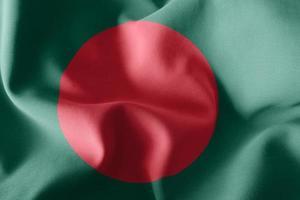 Representación 3D de la ilustración de la bandera de Bangladesh ondeando en el fondo de la bandera del viento foto