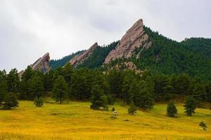 Flatirons dark granite mountains in Chautauqua Park in Boulder Colorado photo