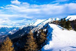 Snowy mountains of the Sugana valley photo