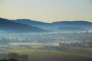 Autumn fog in front of Sovizzo, on the hills of Vicenza, Veneto, Italy photo