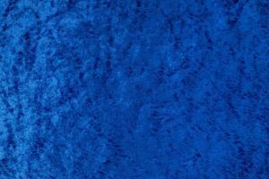 tela de terciopelo uniforme brillante azul oscuro como fondo foto