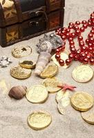 Golden coins with marine treasures photo