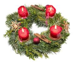 Top view of a decorated Christmas wreath made of fir branches with burning red candles photo