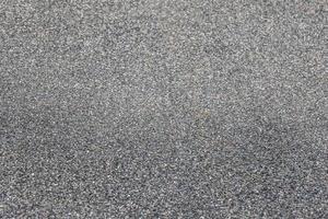 Carretera recubierta de alquitrán de asfalto gris oscuro como fondo foto