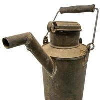 Old dirty oil can of tin with carrying handle isolated on white photo