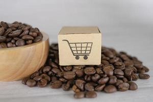 Box with shopping cart logo symbol on coffee beans photo