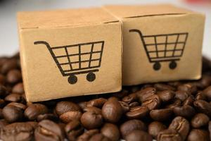 Box with shopping cart logo symbol on coffee beans Import Export Shopping online or eCommerce delivery service store product shipping trade supplier concept photo
