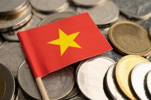 Stack of coins with China flag on white background photo