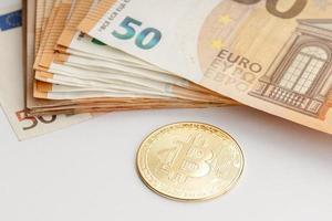 Bitcoin coin and Euro banknotes Blockchain money versus fiat money concept photo