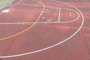 Multi sport game court with aged red floor photo