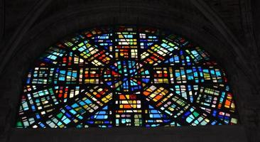 City, Country, MM DD, YYYY - Beautiful medieval stained glass window adorning a castle window photo