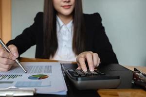 Accountant using calculator photo