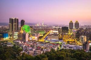 Skyline of Taipei city at night with ferris wheel photo