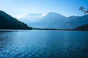 Lake Levico with the mountains in the background in Trento, Italy photo