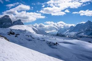 Snow covered valleys in the Dolomites photo