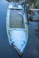 Wooden fishing boat abandoned and almost sunk photo