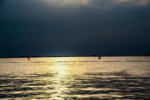 Sunset over the Venice Lagoon, Italy with golden reflections on the sea photo