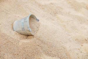 Bucket in the sand pile photo