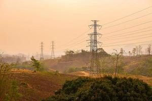 High voltage pole on mountain photo