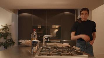 Woman taking frying pan in kitchen talking to man video