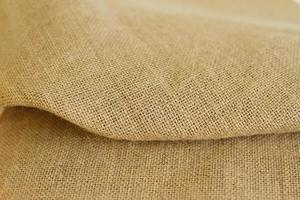Sackcloth brown textured background burlap fiber photo
