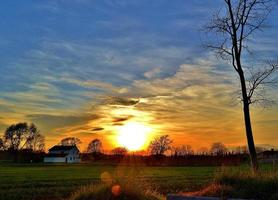 White country house at sunset with blue sky photo