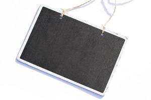 Mini blackboard on white background photo