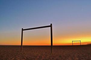 Goals on the beach at sunset photo