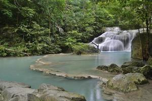 beautiful waterfalls of turquoise water in the middle of the jungle photo