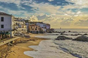 Seafront Calella town beach sunset photo