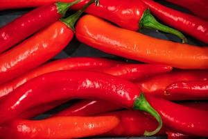 Ripe red hot chili peppers photo