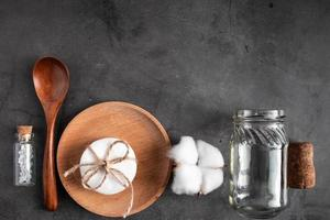 Set of recyclable accessories made of wood and glass on a concrete background photo