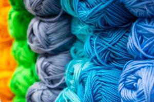 The texture of multicolored fluffy woolen threads for knitting photo