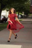 Girl running in heels on pavement photo