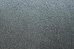 Granito natural oscuro u otro espacio de copia de fondo en blanco mineral foto