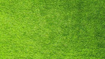 Artificial green grass background photo