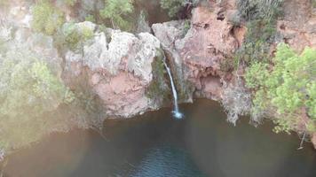 Pego do Inferno,  small waterfall in Santo Estevao, Tavira, Algarve. Aerial dolly out video