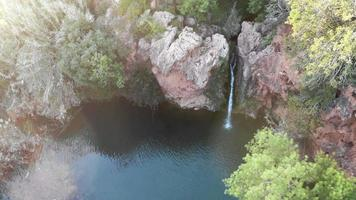 Waterfall of Pego do Inferno at dusk in Tavira, Algarve, Portugal - High angle Orbit Aerial video